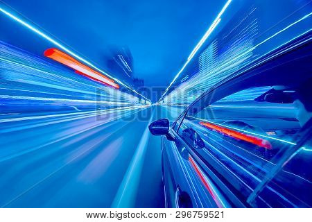 View From Side Of Car Moving In A Night City, Blured Road With Lights With Car On High Speed. Concep