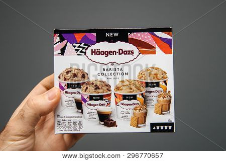 Paris, France - Apr 6, 2019: Man Hand Holding Against Gray Background Package Of Haagen-dazs Barista