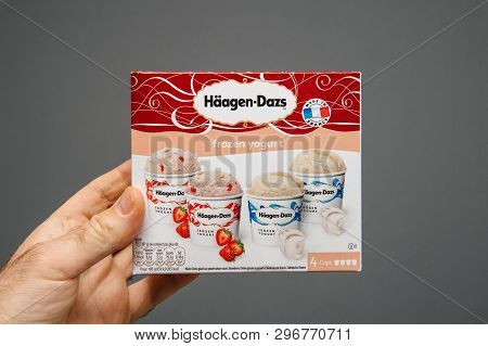 Paris, France - Apr 6, 2019: Man Hand Holding Against Gray Background Package Of Haagen-dazs Frozen