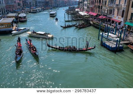 Venice, Italy - April 17 2019: Gondolas And Boats In Canale Grande, Grand Canal In Venice, One Of Th