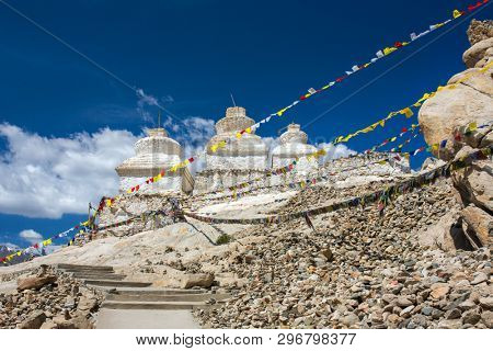 Buddhist chortens or stupas and Himalayas mountains in the background near Shey Palace in Ladakh, India