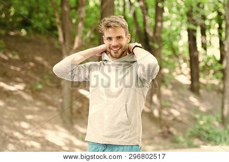 Feeling Comfortable. Guy Bearded Attractive Casual Put Hood On . Man With Bristle Smiling Face Natur