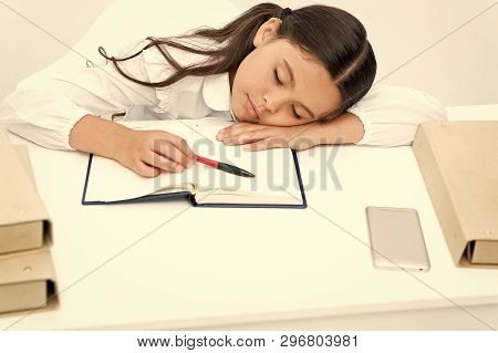 Fall Asleep On Lesson. Girl Child Fall Asleep While Reading Book Table White Background. Schoolgirl