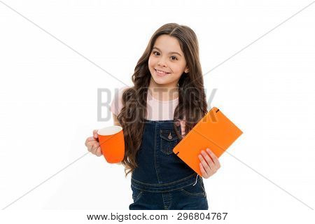 Fuel Your Mind And Body In Morning. Cute Schoolgirl Holding Cup And Note Book. Little Kid Drinking M