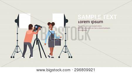 Professional Man Photographer Using Dslr Camera On Tripod Shooting African American Woman Model Girl