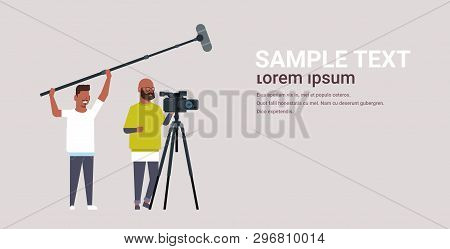 Operators Using Video Camera On Tripod Holding Microphone African American Men Working With Professi