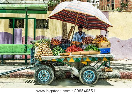 Aswan Egypt 20.05.18 Men Vegetable Seller With Rolling Store On The Street In The City