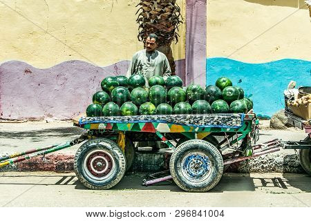 Aswan Egypt 20.05.18 Men Watermelon Fruit Seller With Rolling Store On The Street In The City