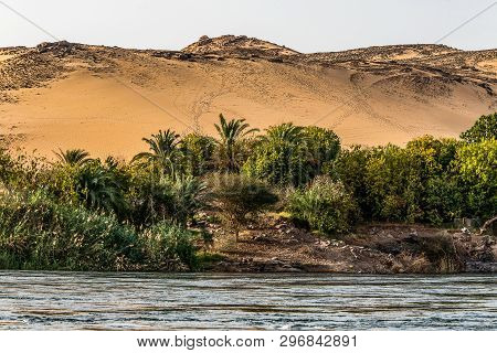 Sunset, Sand Dunes On The Coastline Of The Nile River Part Called First Cataract, Aswan Egypt