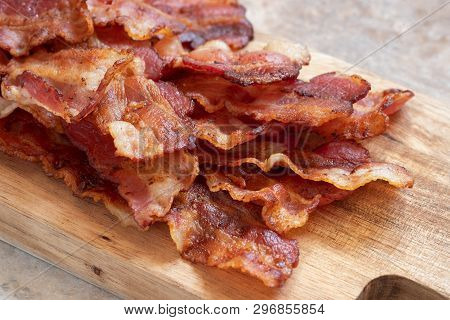 Cooked Greasy Bacon On A Wood Board