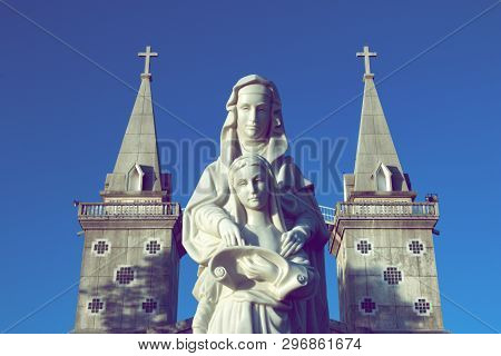 Nakhon Phanom - Thailand, January 14, 2018: Statues Of Saint Ann And Child Virgin Mary Stand In Fron