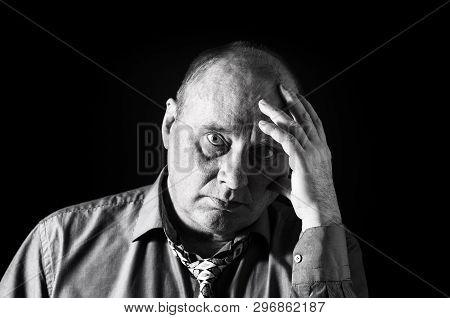 Nice Monochrome Portrait Of Pensive Office Clerk Against Black Background