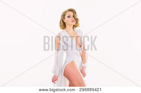 Woman Elegant Lady With Retro Hairstyle And Makeup Posing In White Dress Decollete. Vintage Fashion