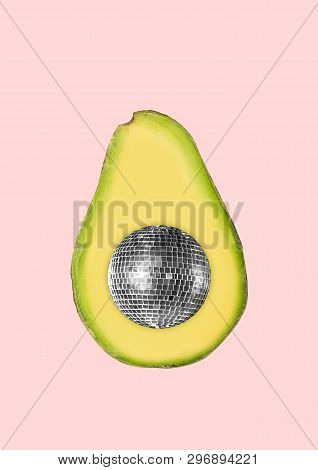 The Summers Vibes. A Half Of Avocado With The Discoball Inside On Trendy Coral Background. Negative