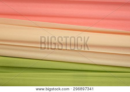 lime green, cream and salmon crepe paper - background with crinkled texture