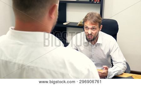 manager in the office. the employee who received the notice, a letter or a document with unexpected news from the boss, poster