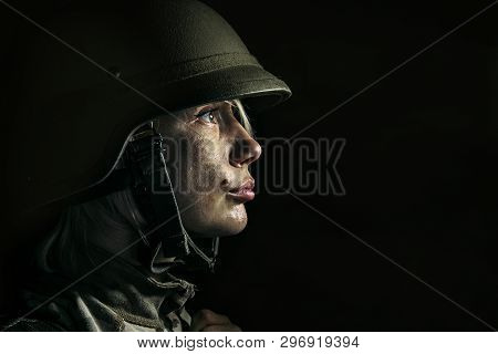 Hell On The Earth Is Real And Material. Close Up Portrait Of Young Female Soldier. Woman In Military
