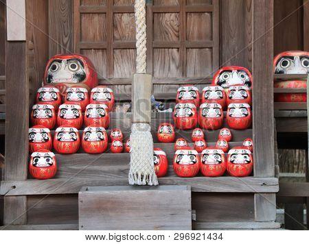Traditional japanese daruma dolls in a shrine, Kurashiki city, Japan