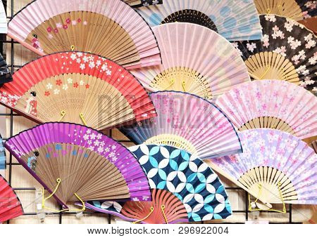 Souvenirs - traditional Japanese fans with sakura flowers ornaments