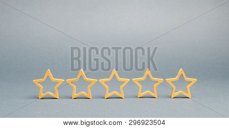 Five Stars On A Gray Background. The Concept Of The Best Housing, Luxury Apartments Vip Class. The B