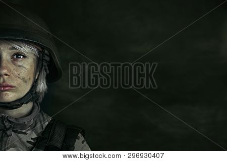 Its Only Half Of Me Fighting. Close Up Portrait Of Young Female Soldier. Woman In Military Uniform O