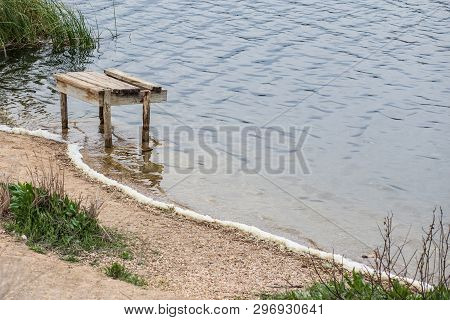 Jetty Of A Calm Lake Of Salt Water