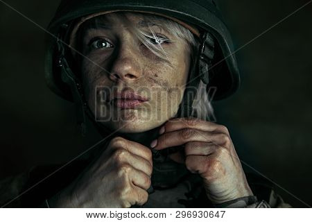Preparing For Being Stronger Like A Stone. Close Up Portrait Of Young Female Soldier. Woman In Milit