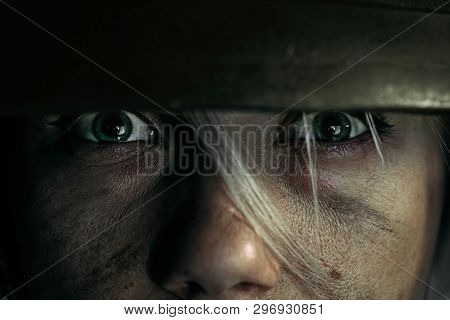 Green Eyes Full Of Stronght And Hatred. Close Up Portrait Of Young Female Soldier. Woman In Military