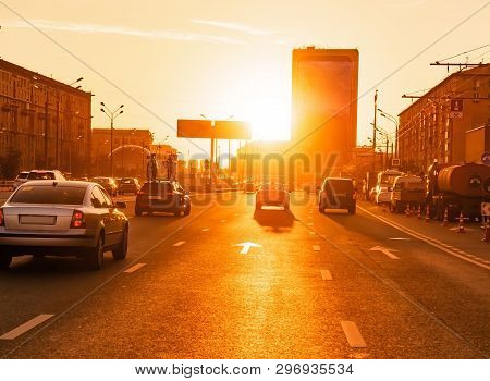 Cars Are In A City Traffic During A Beautiful Golden Sunset In A Moscow.