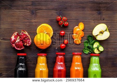 Bottles With Fresh Carrot, Tomato, Apple, Cucumber, Lemon, Pomegranate Juices On Wooden Background T