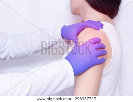 A Doctor Examines The Sore Shoulder Of A Patient With Inflammation And Stiffness In The Shoulder Joi