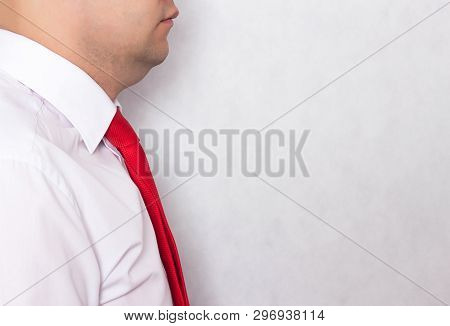 Office Worker Man In A Tie With A Problematic Double Chin On A White Background, Copy Space, Weight