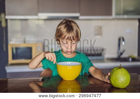 Happy Little Blond Kid Boy Eating Cereals For Breakfast Or Lunch. Healthy Eating For Children. Child