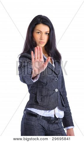 Serious business woman making stop sign over white