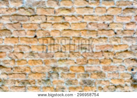 Defocused Background Of Stone Brick Wall Texture With Copy Space. Intentionally Blurred Post Product