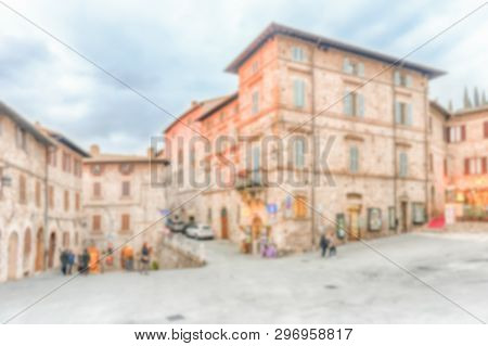 Defocused Background Of The Picturesque And Ancient Streets Of Assisi, One Of The Most Beautiful Med