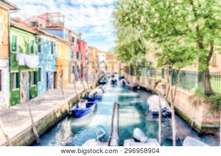 Defocused Background Of Colorful Houses Along The Canal On The Island Of Burano, Venice, Italy. Inte