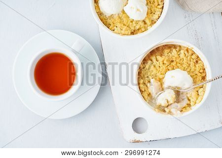 Apple Crumble With Ice Cream, Streusel. Morning Breakfast With Tea On Light Gray Table. Top View, Cl