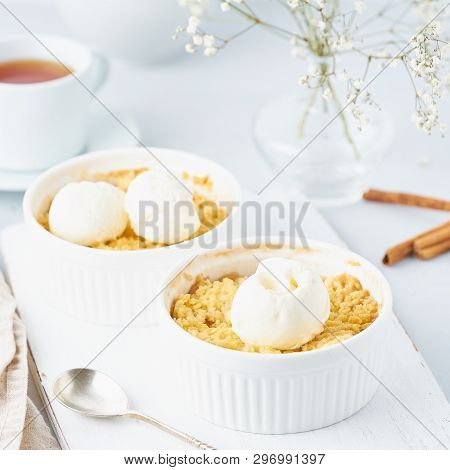Close Up Apple Crumble With Ice Cream, Spoon With Streusel. Side View, Vertical. Morning Breakfast O