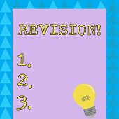 Word writing text Revision. Business concept for action of revising over someone like auditing or accounting Incandescent Light Bulb with Filament Inside Resting on Blank Color Paper. poster