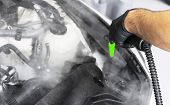 Car detailing. Car washing and cleaning engine. Cleaning car engine using hot steam. Hot steam engine washing. Car wash station. Man cleaning vehicle. Car wash concept poster