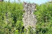Ancient gravestone cross on Orthodox graveyard in Serbia poster