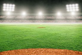 Baseball Field At Brightly Lit Outdoor Stadium. Focus On Foreground And Shallow Depth Of Field On Ba