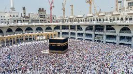 MECCA,SAUDI ARABIA-SEPTEMBER 24, 2016: Muslim piligrims praying around Kaaba in Al-Haram Mosque in Mecca, the largest mosque in the world