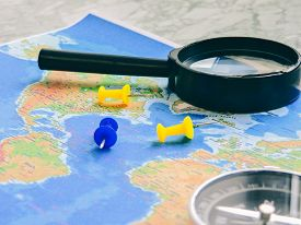 Top View Of A Map And Items. Planning A Trip Or Adventure. Travel Planning Dreams. Map Of The World.
