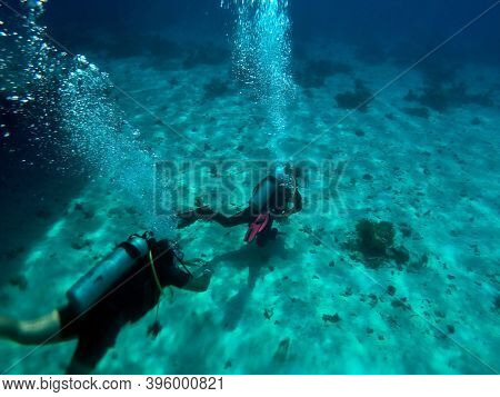 Scuba divers in the blue water. Sharm El Sheikh, Egypt on November 6, 2020