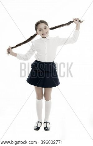 Proud Of Her Long Hair. Kid Girl Charming Ponytail Hairstyle Cute Happy White Background. Child Form