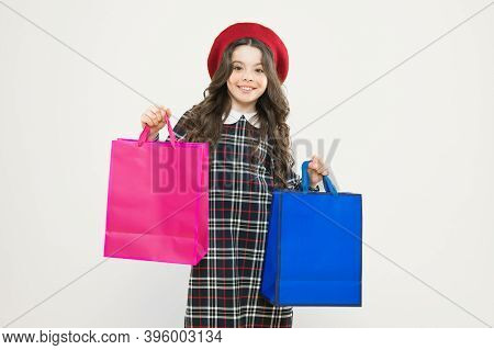 Shopping. Child With Shopping Bag. Little Beauty Shopaholic. Holiday Present. Parisian Child On Yell
