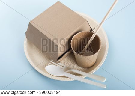 Biodegradable Plate, Cup, Burger Box And Cutlery On Light Blue Background. Recycling Concept.