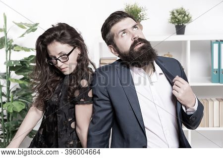 Tired Man With Beard And Sexy Woman. Young Coworkers. Businesspeople. Teamwork. Business Couple In O